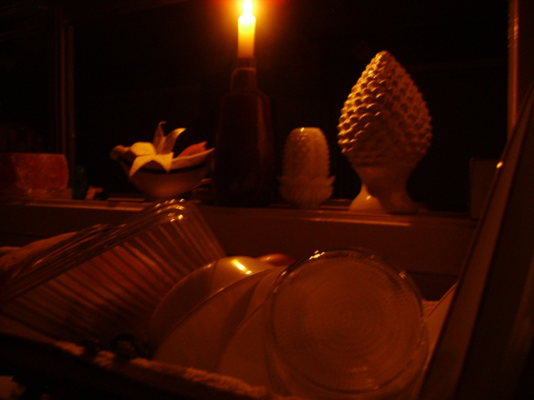 Dishes done by candlelight after Winter Storm Octavia